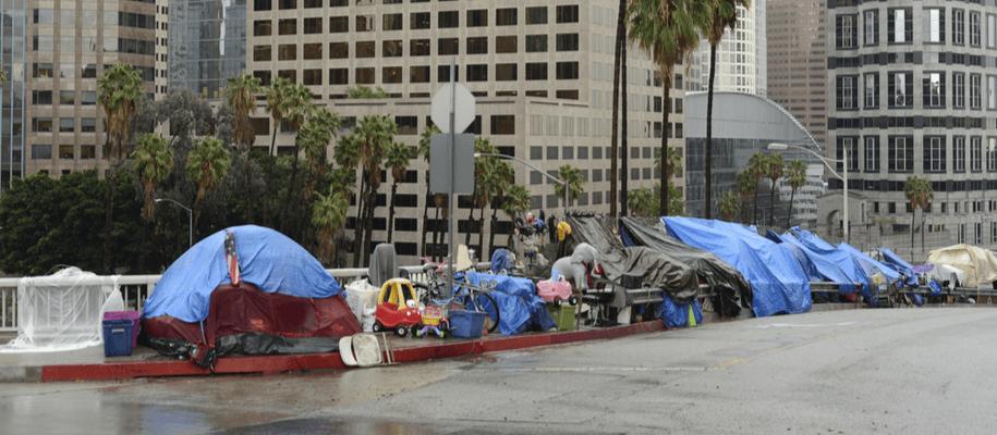 Homeless encampment on Los Angeles County sidewalk.