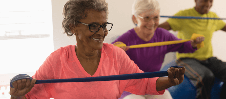 A group of seniors exercising in a recuperative care facility.